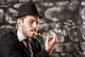 Gangster view of a man is smoking a cuban cigar Royalty Free Stock Image