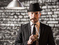 Gangster view of a man is smoking a cuban cigar and holding money Royalty Free Stock Photo