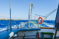 Gangway of the ship sea lifebuoy hanging on a raised going in Royalty Free Stock Photography