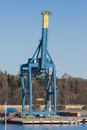 Gantry crane on the dock port is idle with raised boom Stock Images