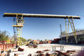 Gantry crane old yellow view from industrial yard Stock Photo