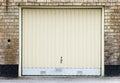Garage door on brick wall Stock Image