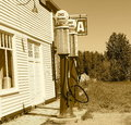 Garage With Gas Pumps In Sepia Royalty Free Stock Photo