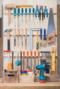 Garage rack tool with various tools and repair supplies on board Royalty Free Stock Photography