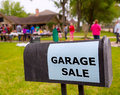 Garage sale in an american weekend on the yard green lawn Royalty Free Stock Photography