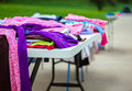 Garage sale clothes laid out on a table at a Stock Photo