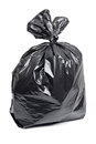 Garbage bag black isolated on a white background full plastic rubbish filled with trash Stock Image