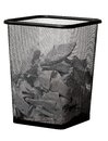 Garbage bin with paper waste isolated on white background Royalty Free Stock Photo