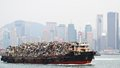 Garbage boat being hauled on in victoria harbor october in hong kong china the dense population means its existing landfills are Royalty Free Stock Photography