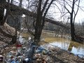 stock image of  Garbage, bottles, mud in the spring. Environmental disaster.