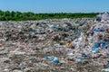 Garbage dump in forest environmental eyesore Royalty Free Stock Photo