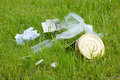 Garbage on the green lawn environmental pollution Stock Photo