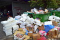Garbage heaps on street overfilled fish market waste containers eyesore maybe someone strike again Royalty Free Stock Photography
