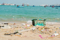 Garbage and plastic bottles on the beach Royalty Free Stock Photo