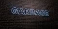 GARBAGE -Realistic Neon Sign on Brick Wall background - 3D rendered royalty free stock image