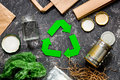 Garbage for recycling with recycling symbol on grey table background top view