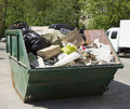 Garbage removal green tank with to the dumpt Stock Photography