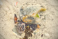 Garbage in shallow water, beach polluted by people. Royalty Free Stock Photo