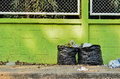 Garbage and waiste in black bags Royalty Free Stock Photo