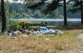 Garbage waste in the woods by the lake