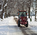 Garching, Germany -small salt truck at work on wintertime Royalty Free Stock Photo