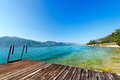 Garda lake with small pier italy lago di the largest italian of glacial origin veneto lombardy and trentino alto adige Stock Images