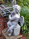 Garden angel in repose concrete Stock Photography