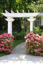 Garden arbor and pink flowers. Royalty Free Stock Image