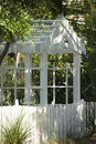 Garden arbor with trees. Royalty Free Stock Image