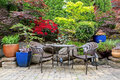 Garden Backyard Landscaping with Bistro Furniture springtime Royalty Free Stock Photo