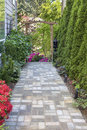 Garden Brick Paver Path with Arbor Royalty Free Stock Photo