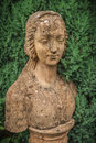 Garden bust of a woman on a plinth Stock Image