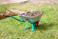 The garden cart with  heap of dry leaves Royalty Free Stock Photography