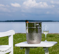 Garden chair and champagne by Chesapeake bay Stock Photo