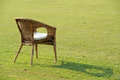 Garden chair on grass green Royalty Free Stock Images