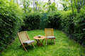 Garden chairs on the backyard Royalty Free Stock Photo