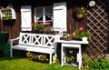 Garden cottage summer white furniture many flowers Stock Photo