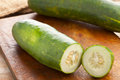 Garden cucumbers sliced on wooden cooking board Stock Photography