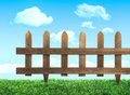 Garden fence with grass and summer sky Royalty Free Stock Photos