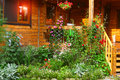 Garden with flowerbed and house porch Royalty Free Stock Photo
