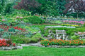 Garden with flowerbeds, plants in a park Royalty Free Stock Image