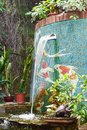 Garden fountain surrounded by plants. A cozy quiet place to relax in nature