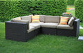 Garden furniture a sofa with cushions in the for relaxation Stock Photo
