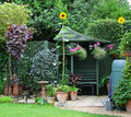 Garden Gazebo, flowerpots and sunflowers Royalty Free Stock Photo