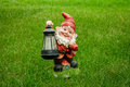 Garden gnome green grass lantern dwarf elf night light decoration Stock Image