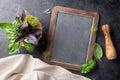Garden herbs in mortar and blackboard