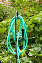 Garden hose growing organic vegetables in community Royalty Free Stock Photography
