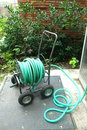 Garden hose a in a reel cart Stock Photography