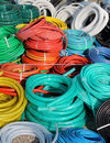 Garden hoses big pile of colorful plastic Royalty Free Stock Image