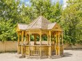 Garden house carved wooden gazebo in the city park Royalty Free Stock Images